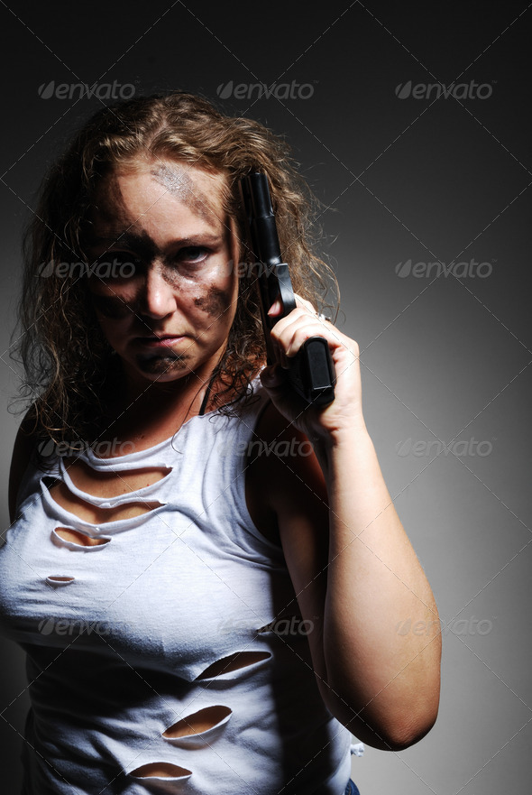 Serious woman with handgun - Stock Photo - Images