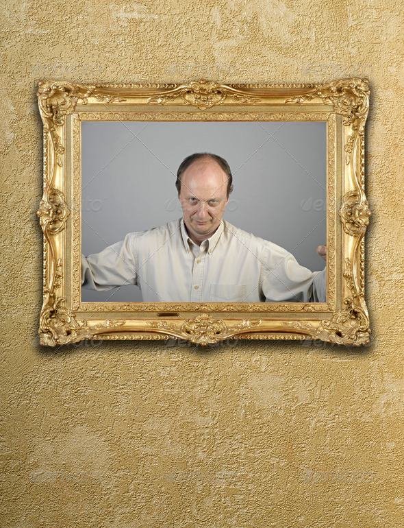 Portrait in gold frame on wall - Stock Photo - Images