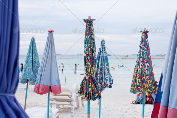 Umbrellas on the beach at Koh Lan - Stock Photo - Images