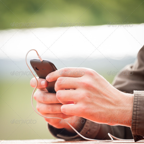 Holding a mobile smart phone - Stock Photo - Images