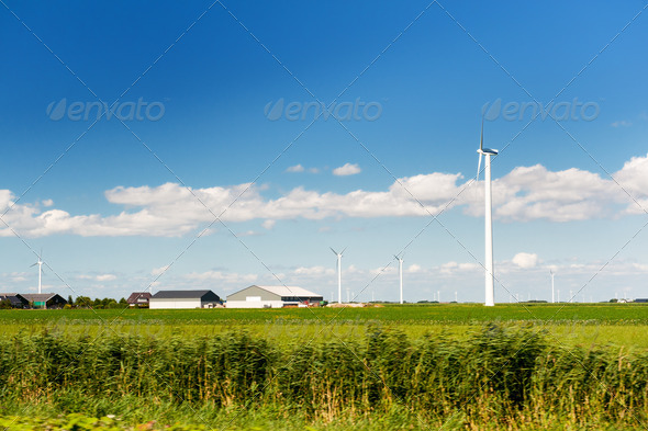 Wind turbines in agriculture landscape - Stock Photo - Images