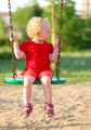 Little girl on a swing in the park - PhotoDune Item for Sale