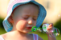 Little girl blowing soap bubbles - PhotoDune Item for Sale