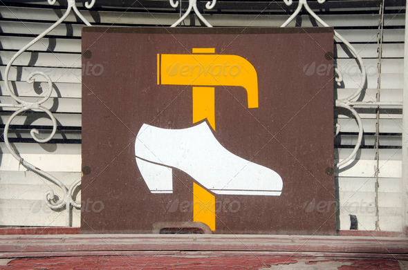 Shoe repair shop sign on window. hammer and shoe - Stock Photo - Images