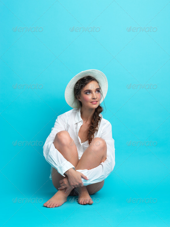 studio, fashion portrait, young woman, blue background - Stock Photo - Images