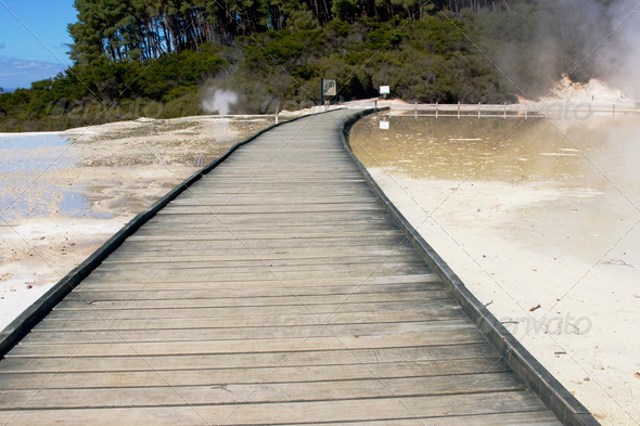 Wooden boardwalk through thermal area - Stock Photo - Images