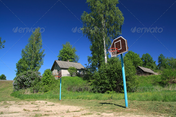 basketball ring on rural atheletic stadium - Stock Photo - Images