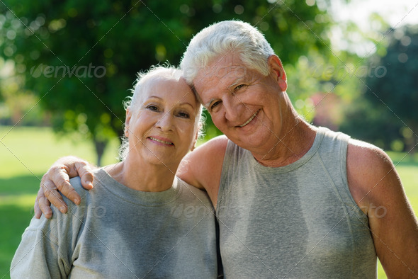 Portrait of elderly couple after fitness in park - Stock Photo - Images