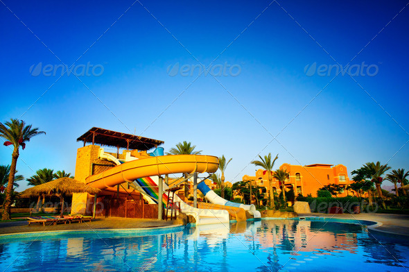 Colorful aquapark  in the  swimming-pool. - Stock Photo - Images