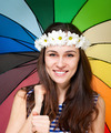 Young woman in chamomile wreath with colorful umbrella - PhotoDune Item for Sale