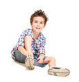 Naughty hairy little boy in shorts and shirt putting on shoes - PhotoDune Item for Sale