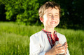 Little ukrainian boy drinks milk outdoors - PhotoDune Item for Sale