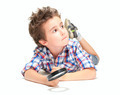 Pensive little boy with weird hair and magnifier - PhotoDune Item for Sale