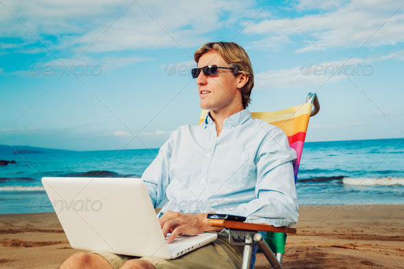Business man on the beach - Stock Photo - Images