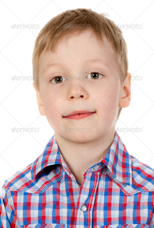 portrait of a boy in a plaid shirt - Stock Photo - Images