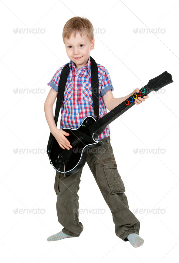 The boy with the electronic guitar - Stock Photo - Images