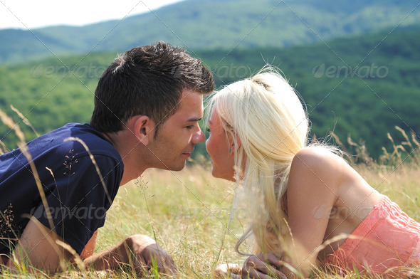 Young couple in nature - Stock Photo - Images