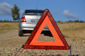 warning triangle behind a car - PhotoDune Item for Sale