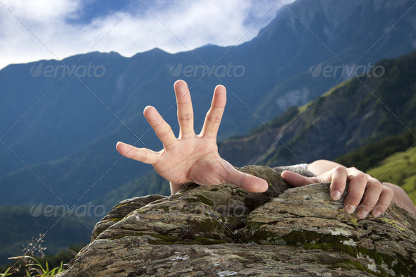 hand for help on the mountain - Stock Photo - Images