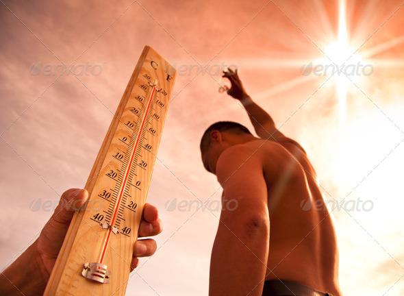 man throwing water for cooling temperature and hand holding thermometer under heat weather - Stock Photo - Images
