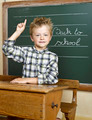 Cheerful smiling child at the blackboard. School concept - PhotoDune Item for Sale