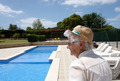 A senior lady at the outdoor  pool side - PhotoDune Item for Sale