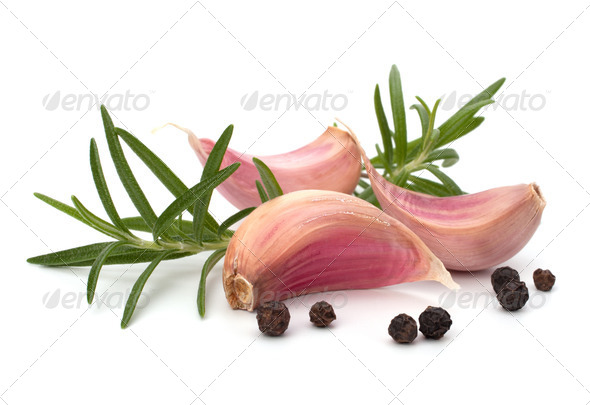Garlic clove and rosemary leaf - Stock Photo - Images