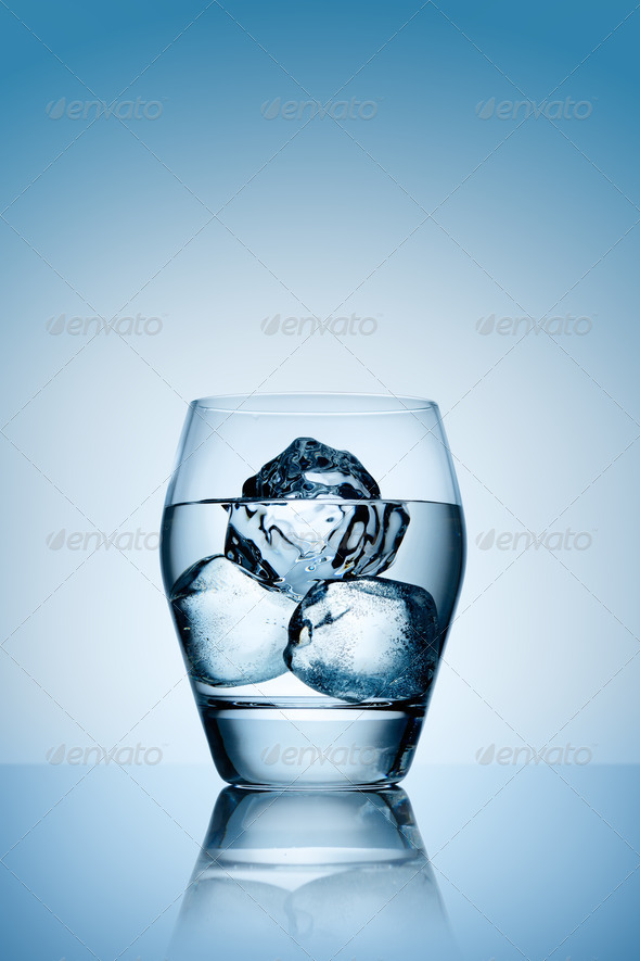 Ice in glass of vodka. - Stock Photo - Images