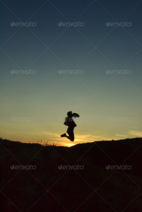 Girl Silhouette Jumping In Sunset - Stock Photo - Images