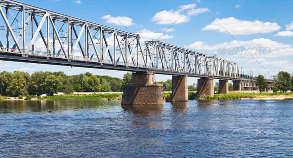 railroad bridge through river - Stock Photo - Images