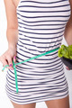Young attractive woman with a measuring tape - PhotoDune Item for Sale