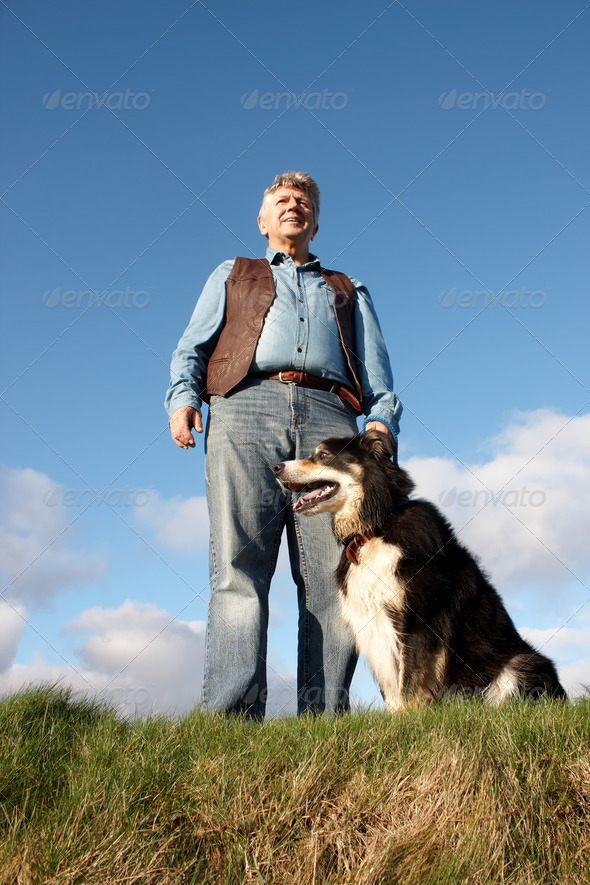 Mature man and his dog - Stock Photo - Images