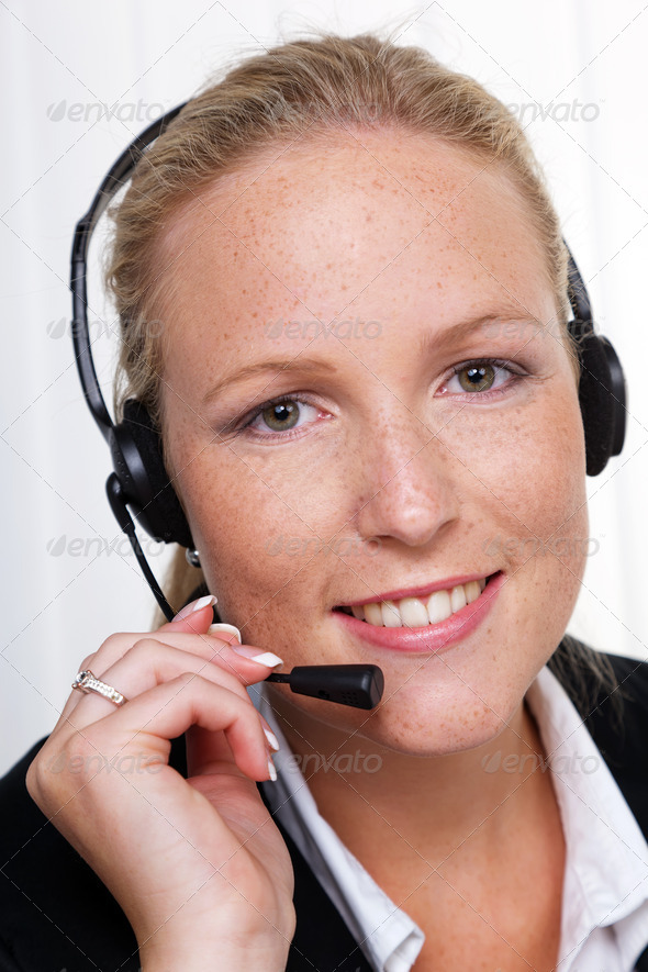 friendly woman with a headset in customer service - Stock Photo - Images