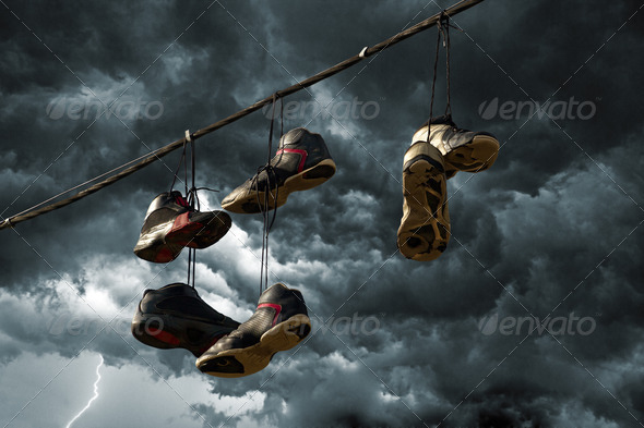 Sneakers Hanging on a Telephone Line - Stock Photo - Images