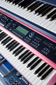 electronic music synthesizer keyboards on rack - PhotoDune Item for Sale