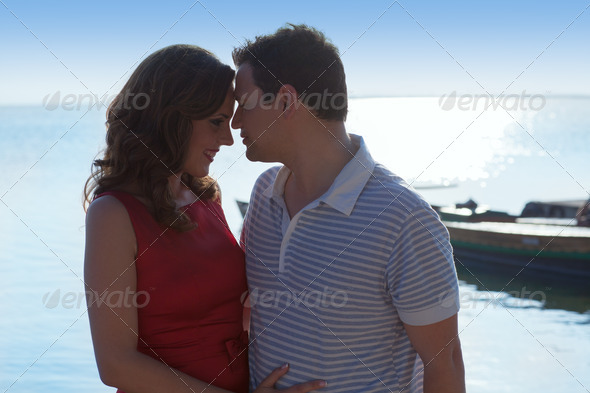 Couple in love hug in suset on sea - Stock Photo - Images