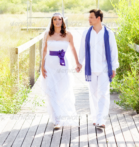 Couple happy in wedding day walking outdoor - Stock Photo - Images