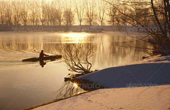 Oarsman on ice cold lake - Stock Photo - Images