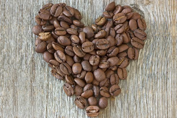 Coffe Beans Heart On Wood Background - Stock Photo - Images