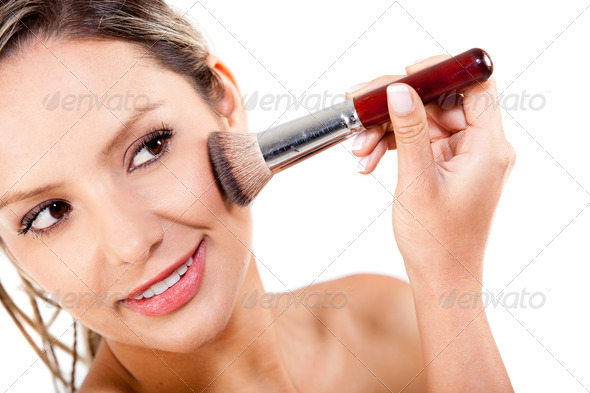Woman applying rouge - Stock Photo - Images
