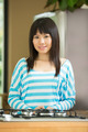 Portrait of a Young Asian woman in kitchen. - PhotoDune Item for Sale