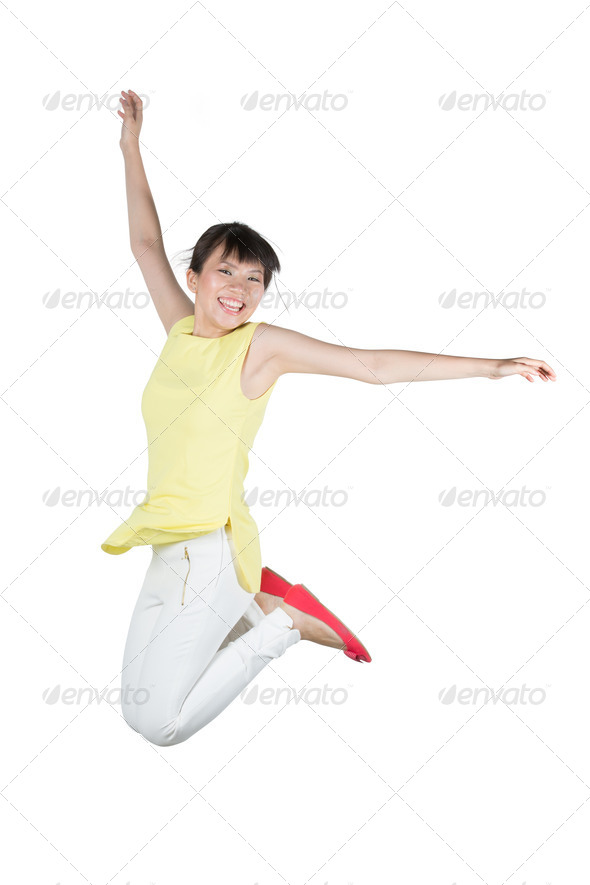 Happy woman jumping in air. - Stock Photo - Images