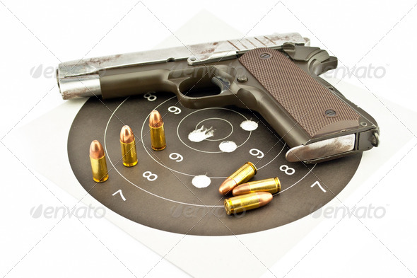 9-mm handgun and target shooting - Stock Photo - Images