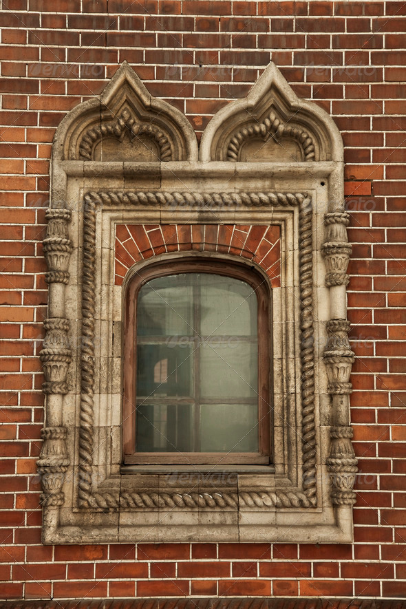 window with ornament in the brick wall - Stock Photo - Images