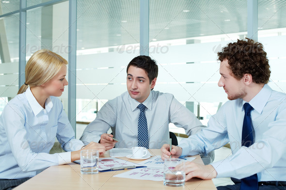 Discussing papers - Stock Photo - Images