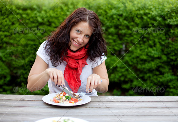 Beautiful Brunette Woman Eating a Salad - Stock Photo - Images