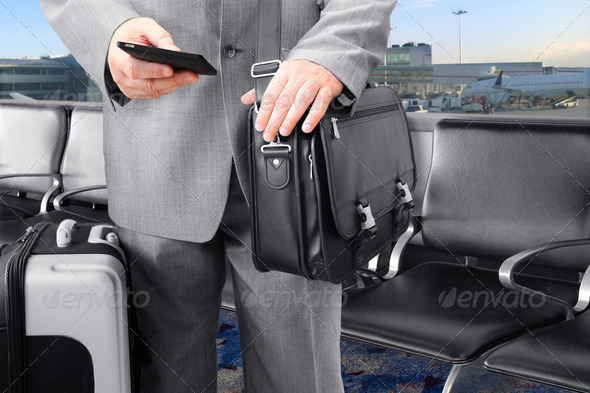Traveling Businessman Calling by Phone at the Airport - Stock Photo - Images