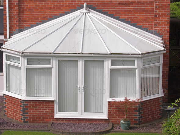 white brick and upvc conservatory - Stock Photo - Images