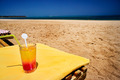 Glass of juice next to beach. - PhotoDune Item for Sale
