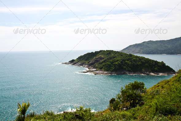 A small island lies off the coast of Phuket, Thailand. - Stock Photo - Images